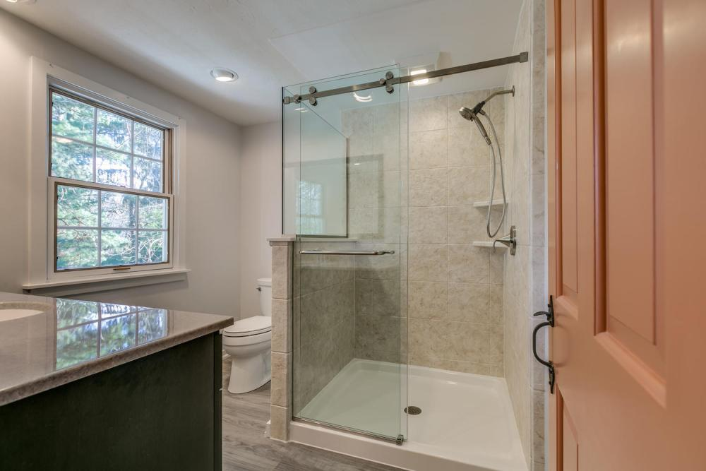 After Re-Bath  Lancaster, PA renovation. We replaced the old closed in shower and opened up the space to allow more light into the bathroom.  This new, larger shower included a knee wall and customer glass shower door.