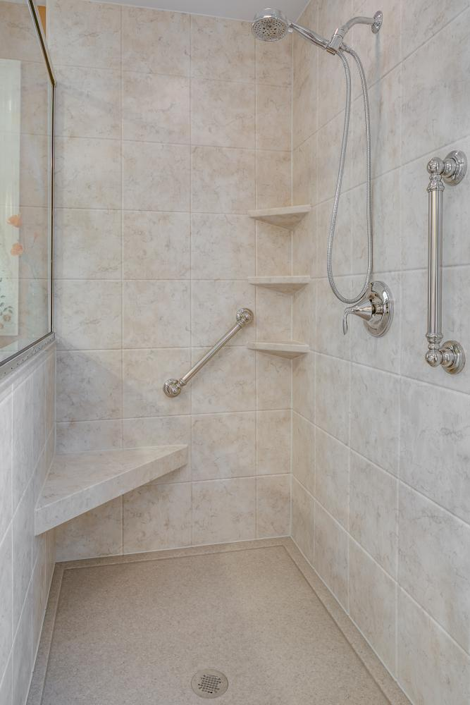 New DuraBsath SSP shower in Tivoli Travertine.  Safe and convenient with a seat, Moen faucet, hand shower and grab bars by Re-Bath  Lancaster, PA