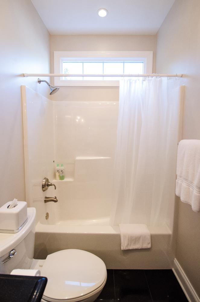 Complete Bathroom Remodel - Re-Bath Bathroom Remodel - Rebath Remodel - Myrtle Beach Bathroom Remodeler - Walk-in Shower - Durabath wall surround - Half bench shower - ada compliant bathroom - master bathroom remodel - natural stone shower - natural stone remodel - natural stone bathroom - stall shower remodel - tub to shower conversion - tub to shower remodel - tub replacement