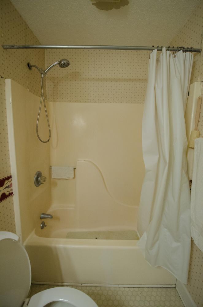 Complete Bathroom Remodel - Re-Bath Bathroom Remodel - Rebath Remodel - Myrtle Beach Bathroom Remodeler - Walk-in Shower - Durabath wall surround - Half bench shower - ada compliant bathroom - master bathroom remodel - natural stone shower - natural stone remodel - natural stone bathroom - stall shower remodel - tub to shower conversion - tub to shower remodel