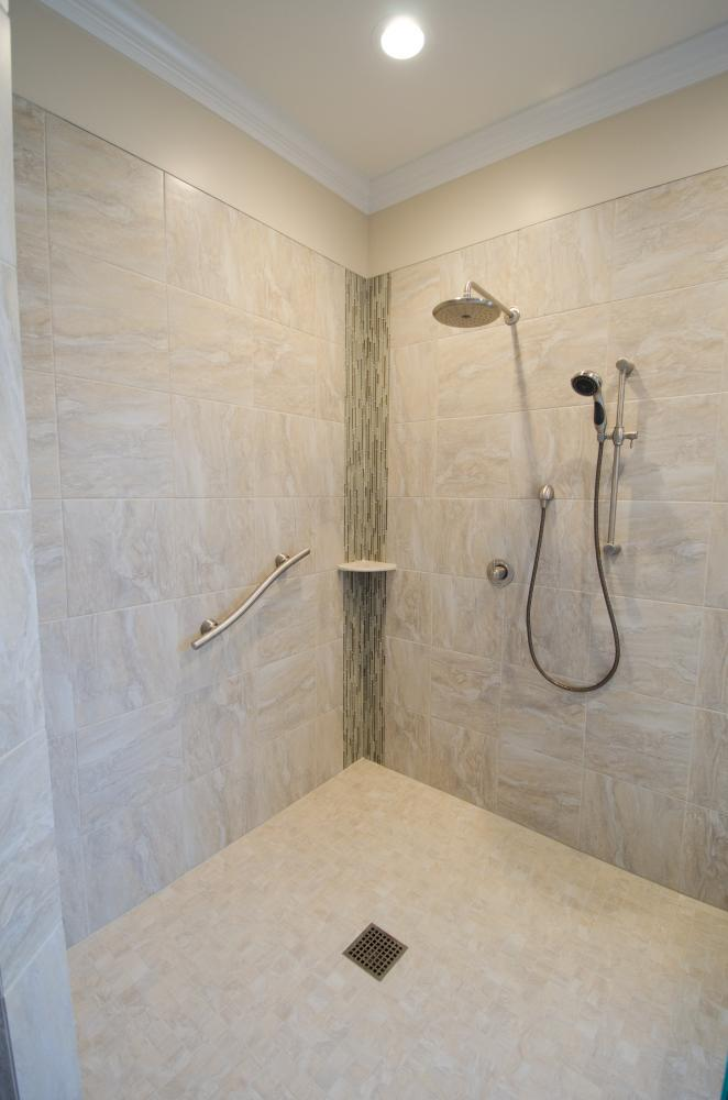Wheelchair accessible shower, safety handlebar, shower shelf, waterfall shower head, and adjustable shower head