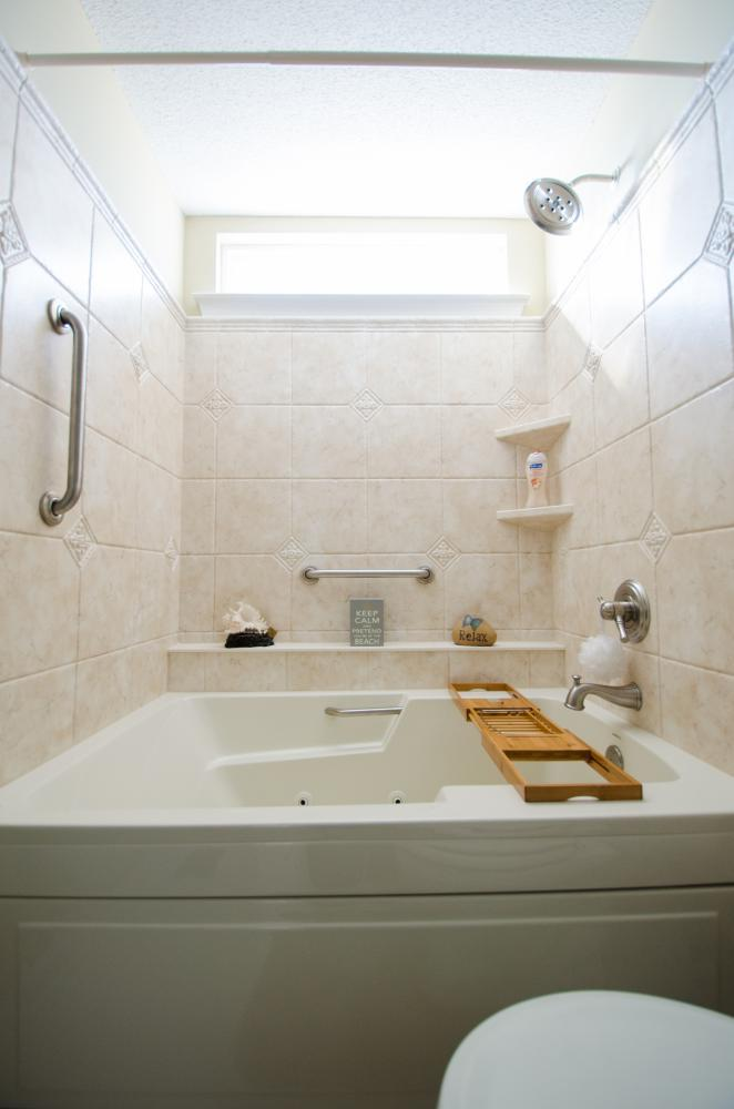 Brand new wall surround, shower head, safety handlebars, shower shelves, and jet tub
