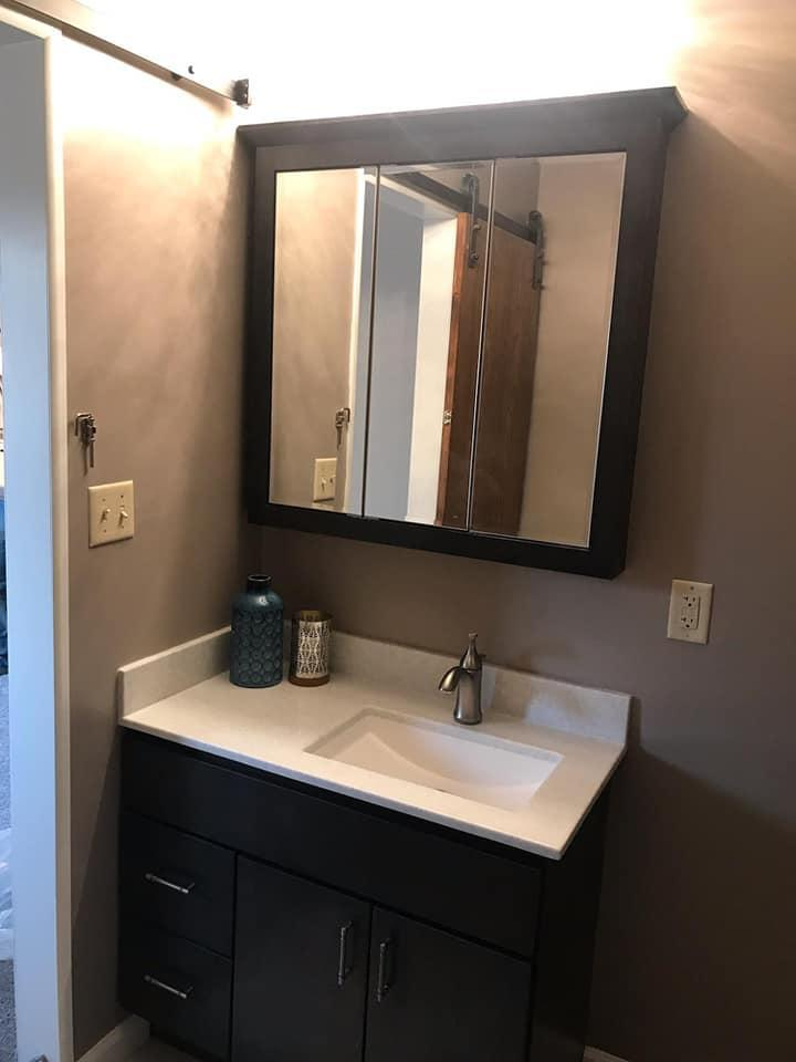 After Re-Bath  Great Bend, KS renovation with a new modern vanity and medicine cabinet fit so much better in this master bath.