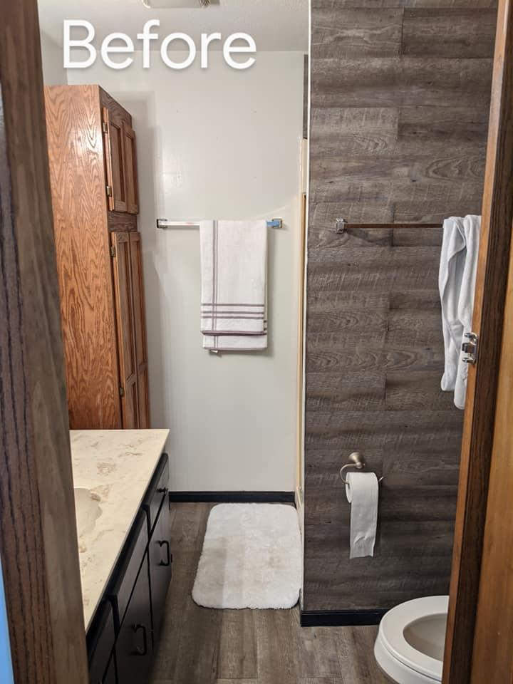 This was a before shot of a super dated bathroom which consisted of a small fiberglass shower and dated oak cabinets.