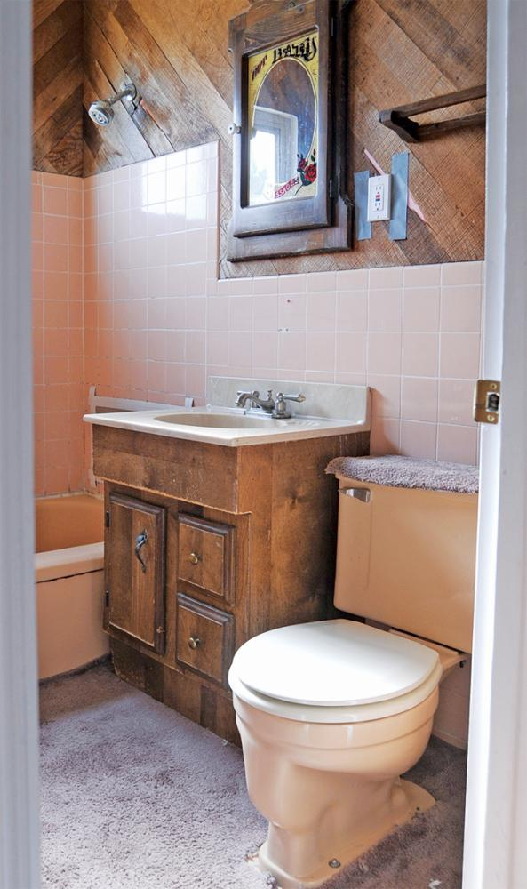 This small outdated bathroom was in need of remodel.  ReBath tore it down to the studs, removing the 50's pink tile and wood on the wall.  The pink fixtures, outdated vanity and carpet that was on the floor were also removed.