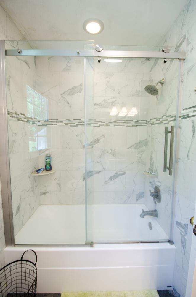 durabath natural stone shower, tub combo, shower doors, corner shelf, pencil stripe tile,