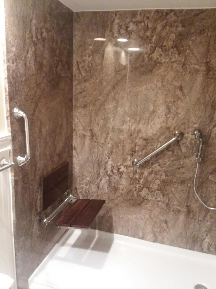 Tub to Shower conversion with barrier free shower pan, seating, and grab bars.