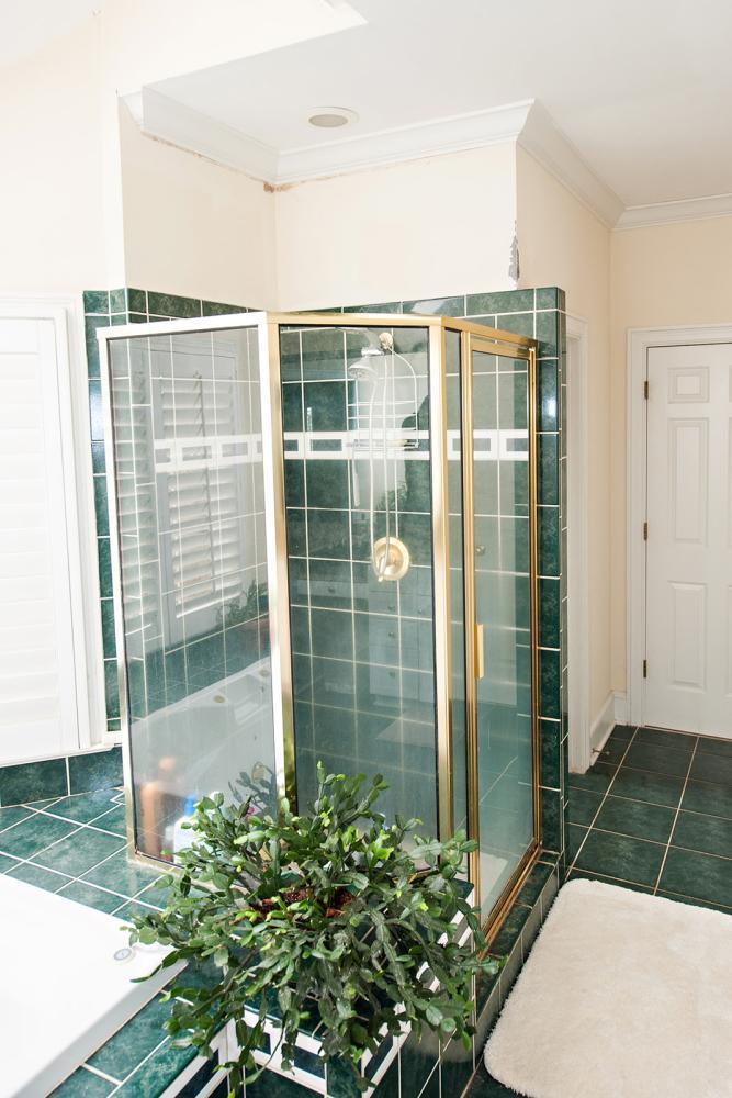 Dated tile shower and gold metal shower frame