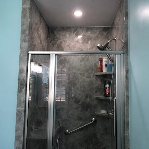 Re-Bath Grey Emperador Walls with an Arizona Door and Fixed Panel. Moen Magnetix Shower