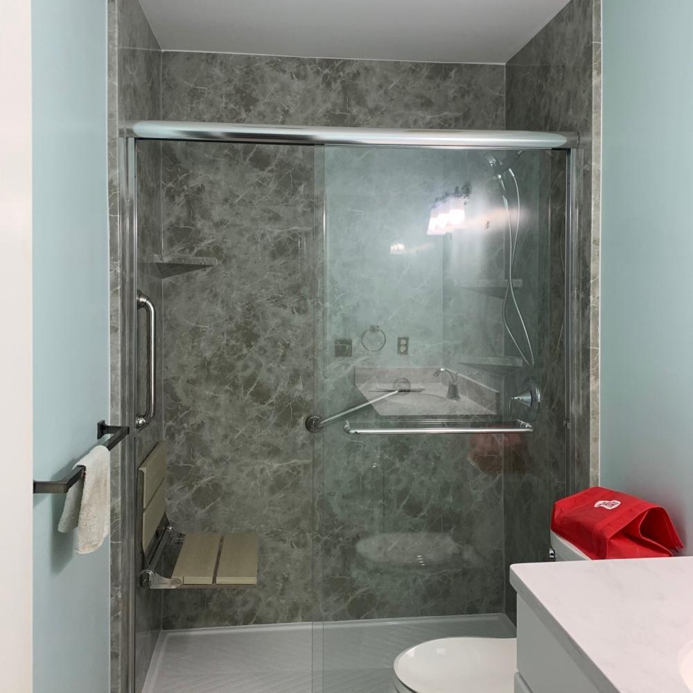 Bilanx waterproof luxwood folding seat.  Grey Emperador Acrylic Walls