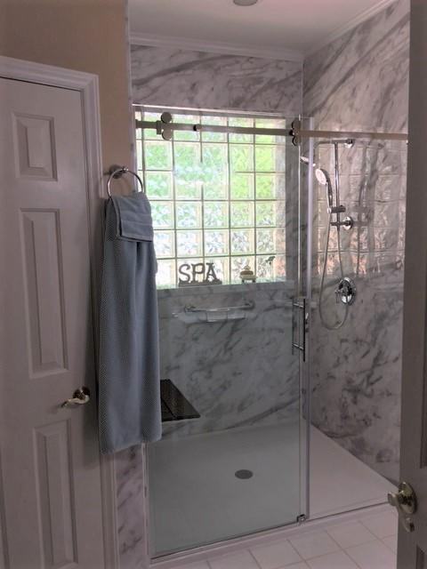 Arizona Shower Door - The Canyon Frameless 3/8  Door and fixed Panel  Moen- Shower Head, Hand Held on a slide bar, and the easy to reach diverter  Re-Bath  -Durabath walls in White Calcutta  Onyx- Low Threshold Shower Base Bilanx- Brazilian Walnut Fold Up Seat